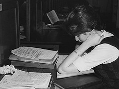 Student reading at a desk