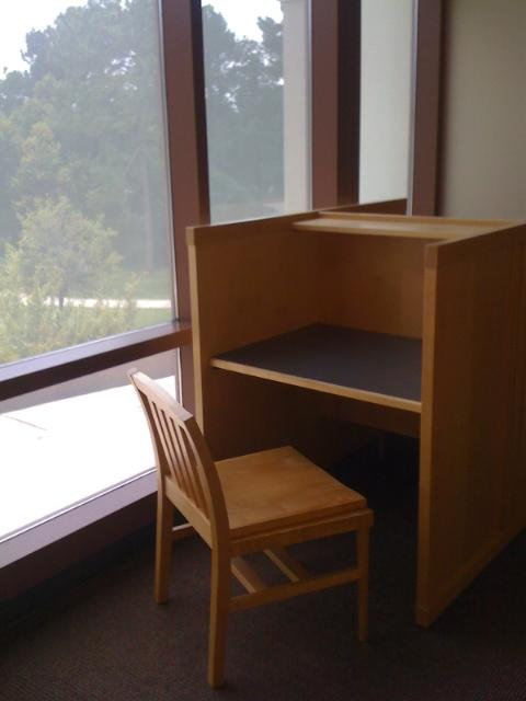 empty desk with wooden chair