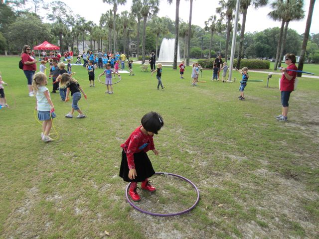 Child standing in a hula hoop