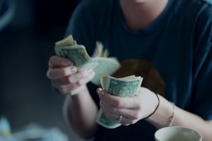Read more about the article The Importance of Financial Wellness: Tips on Saving Money in College